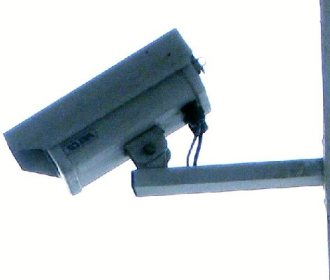 surveilance camera (cc by laurelrusswurm)